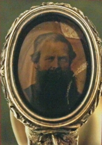 Col. Mathews' image in the pommel of his sword